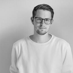 Porträtfoto von Björn Becker, Architekt bei D&CO